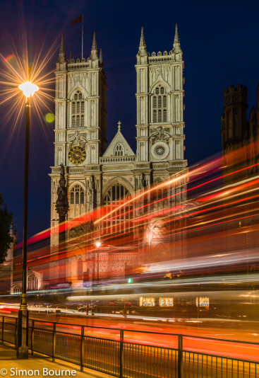 Simon Bourne, photography, photographer, north London, portfolio, image, central London, Westminster, Westminster Abbey, flag, summer, landscape, cityscape, structures, Nikon, landmark, building, lights, dusk, red London bus, buses, night, starburst