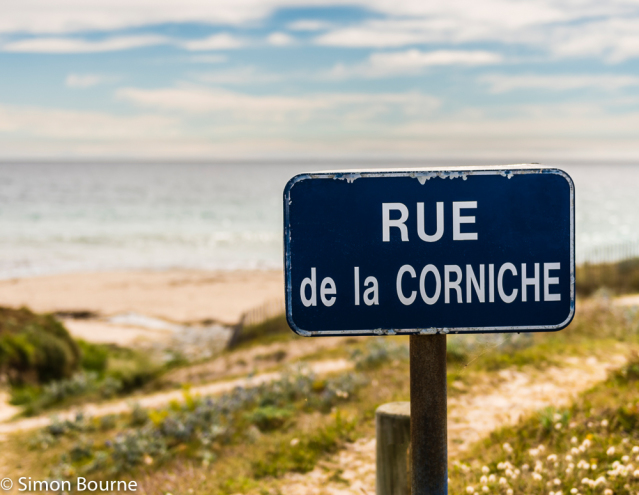 Simon Bourne, photography, photographer, north London, portfolio, image, abstract, Nikon, Brittany, France, Plouhinec, sea, sign, road, rue, corniche, beach, blue sign, sand