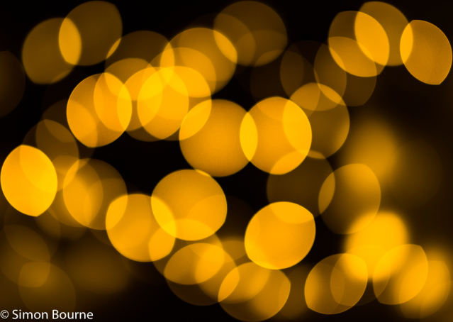 Simon Bourne, photography, photographer, north London, portfolio, image, abstract, reflections, Nikon, bokeh, Xmas tree, fairy, lights, Christmas, orange light, focus