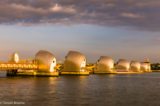 Simon Bourne, photography, photographer, north London, portfolio, image, landscape, structure, bridge, River Thames, river, Nikon, Thames Barrier, long exposure, dusk, sunset, sparkle, orange glow, boat, trails, ship, dam, stainless steel, piers