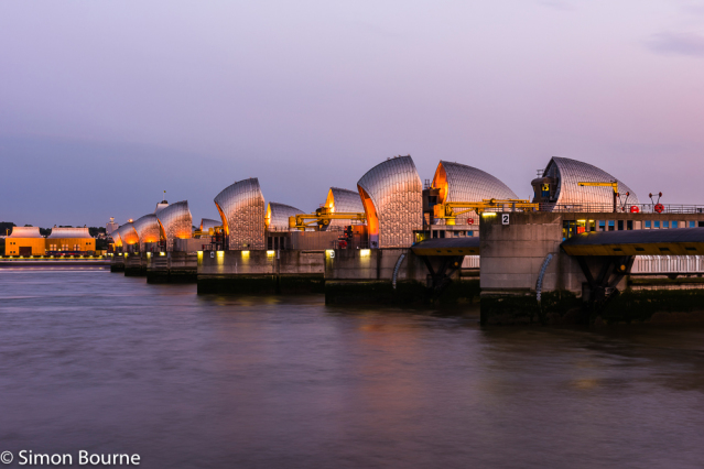 Simon Bourne, photography, photographer, north London, portfolio, image, landscape, structure, bridge, River Thames, river, Nikon, Thames Barrier, long exposure, dusk, lights, boat, ship, trails, orange glow, dam, stainless steel, piers