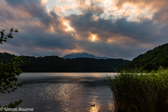 Simon Bourne, photography, photographer, north London, portfolio, image, landscape, Italy, Nikon, Levico Terme, Lago di Levico, Trentino, lake, water, mountain, trees, sunset, dusk, alpine, Dolomites, storm clouds, wildlife, duck, stormy, reeds, bushes