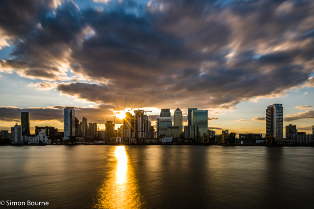 Simon Bourne, photography, photographer, north London, portfolio, image, landscape, structures, River Thames, river, Nikon, cityscape, long exposure, Canary Wharf, dusk, sunset, buildings, reflections, storm clouds, sun, sunburst