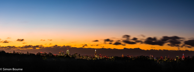 Simon Bourne, photography, photographer, north London, portfolio, image, winter, sunrise, dawn, landscape, trees, Nikon, Hampstead Heath, skyline, The Shard, BT Tower, Canary Wharf, blue skies, lights, orange glow, cityscape, London Eye, panorama, clouds