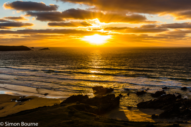 Simon Bourne, photography, photographer, north London, portfolio, image, landscape, seascape, sea, surf, surfing, Nikon, Fistral, Cornwall, sunset, dusk, waves, reflections, crepuscular rays, storm, orange skies