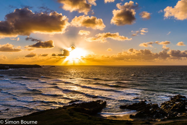 Simon Bourne, photography, photographer, north London, portfolio, image, landscape, seascape, sea, surf, Nikon, Fistral, Cornwall, sunset, dusk, waves, reflections, crepuscular rays, storm, gale, clouds, orange skies