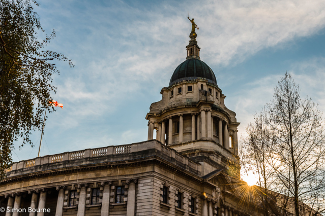 Simon Bourne, photography, photographer, north London, portfolio, image, winter, sunny morning, city, courts, central London, Central Criminal Court, Old Bailey, building, legal, England flag, dome, Lady Justice, bronze statue, sunburst, stonework, masonr