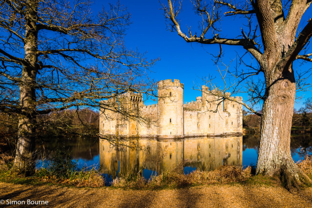 Simon Bourne, photography, photographer, north London, portfolio, image, landscape, Nikon, Bodiam Castle, Sussex, early morning, winter, sun, blue skies, clear sky, reflections, moat, trees, water, lake, stone, fort