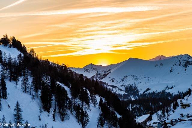 Simon Bourne, photography, photographer, north London, portfolio, image, landscape, Austria, Nikon, Obertauern, alps, alpine, mountain, trees, orange sky, snow, sunset, dusk, clouds, peaks, skiing, ski resort