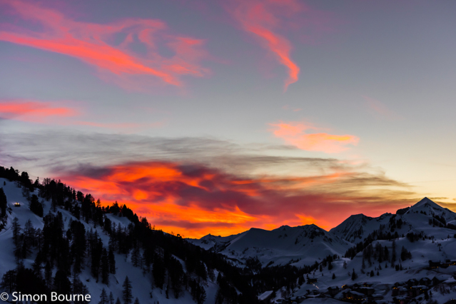 Simon Bourne, photography, photographer, north London, portfolio, image, landscape, Austria, Nikon, Obertauern, alps, alpine, mountain, trees, sky, red skies, snow, sunset, dusk, clouds, peaks, skiing, ski resort, piste-basher