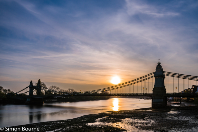 Simon Bourne, photography, photographer, north London, portfolio, image, central London, River Thames, Hammersmith Bridge, sunset, dusk, sun, Nikon, orange sky, blue skies, suspension, cables, reflections