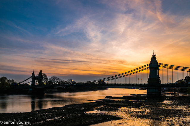 Simon Bourne, photography, photographer, north London, portfolio, image, central London, River Thames, Hammersmith Bridge, sunset, dusk, night, lights, Nikon, orange sky, blue skies, suspension, cables, clouds, reflections