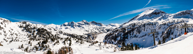 Simon Bourne, photography, photographer, north London, portfolio, image, landscape, Austria, Nikon, Obertauern, alps, alpine, mountain, trees, blue sky, panorama, snow, peaks, skiing, ski resort, chair lift