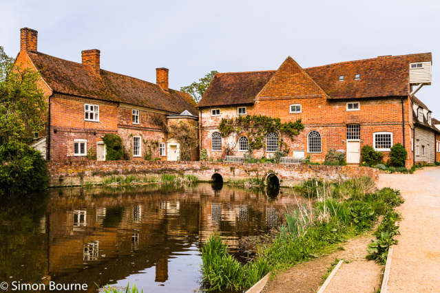 Simon Bourne, photography, photographer, north London, portfolio, image, landscape, Nikon, Flatford Mill, Suffolk, early morning, spring, sun, blue skies, reflections, River Stour, mill pond, water, lake, John Constable, buildings, water mill