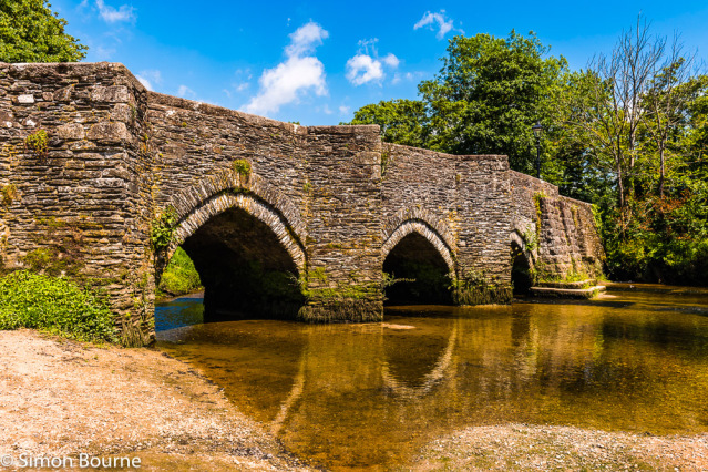 Simon Bourne, photography, photographer, north London, portfolio, image, arched Medieval bridge, structure, Nikon, stone arch, Lostwithiel, Cornwall, River Fowey, summer, sun, blue skies, road