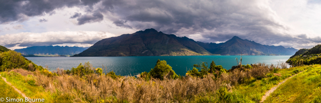Simon Bourne, photography, photographer, north London, portfolio, image, spring, landscape, Nikon, Lake Wakatipu, South Island, Queenstown, New Zealand, Aotearoa, mountains, peaks, storm clouds, aquamarine, glacial, The Remarkables