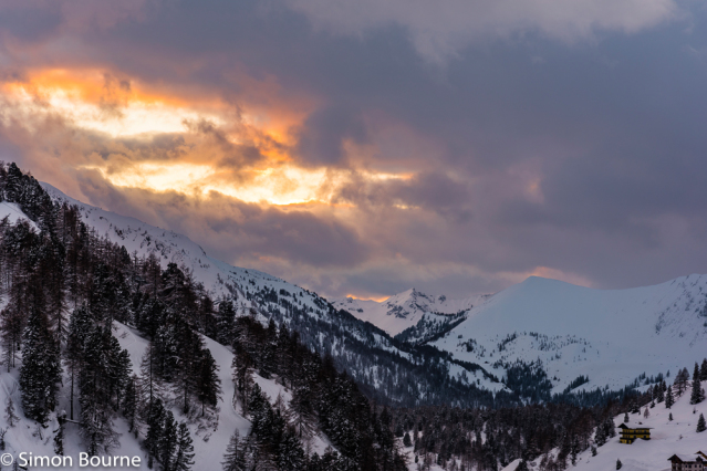 Simon Bourne, photography, photographer, north London, portfolio, image, landscape, Austria, Nikon, Obertauern, alps, alpine, mountain, trees, sky, orange skies, snow, sunset, dusk, clouds, peaks, skiing, ski resort, storm